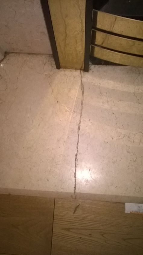 cracked marble floor showing across